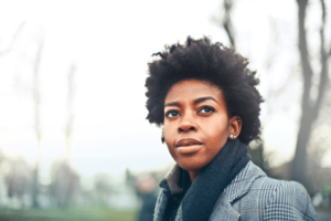 Black Woman thinking about where to go and worrying about her safety